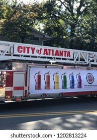 Atlanta, GA - October 14, 2018: Atlanta Pride parade.  The City of Atlanta fire truck decorated for the Pride Parade.