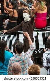 ATLANTA, GA - OCTOBER 15:  A man wearing coveralls and a Michael Myers mask from the Halloween movie series, walks in the Little Five Points Halloween parade, on October 15, 2016 in Atlanta, GA.
