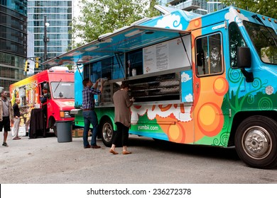 "ATLANTA, GA - OCTOBER 16:  Customers order meals from a popular food truck during their lunch hour, at ""Food Truck Thursday"" on October 16, 2014 in Atlanta."
