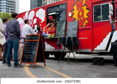 "ATLANTA, GA - OCTOBER 16:  Customers wait in line to order meals from a popular food truck during their lunch hour, at ""Food Truck Thursday"" on October 16, 2014 in Atlanta."