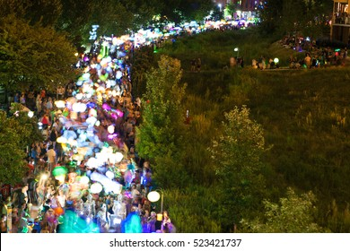 ATLANTA, GA - SEPTEMBER 10:  Motion blur of people walking with lanterns at night along the Beltline in the annual Atlanta Lantern Parade in the Old Fourth Ward, on September 10, 2016 in Atlanta, GA.