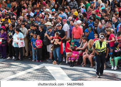ATLANTA, GA - SEPTEMBER 3:  A huge crowd of spectators gathers on Peachtree Street in anticipation of the start of the annual Dragon Con parade Labor Day weekend, on September 3, 2016 in Atlanta, GA.