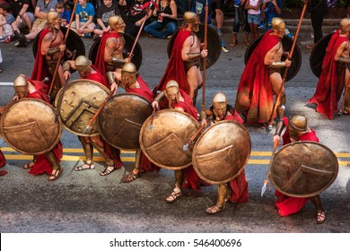 ATLANTA, GA - SEPTEMBER 3:  Men dressed as Spartan warriors from the movie 300, pose with their shields and spears as they walk in the annual Dragon Con parade on September 3, 2016 in Atlanta, GA.