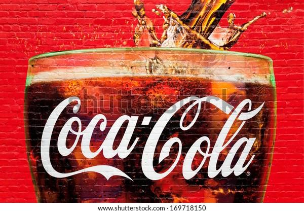 ATLANTA, GA, USA - DECEMBER 04: A glass full of Coca Cola painted in a old wall in Atlanta, Georgia on dec 04, 2013. Atlanta is the home of Coca Cola.