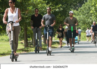 Atlanta, GA / USA - July 6, 2019:  Diverse people ride motorized scooters along the Atlanta Belt Line at the Old Fourth Ward Park, on July 6, 2019 in Atlanta, GA.
