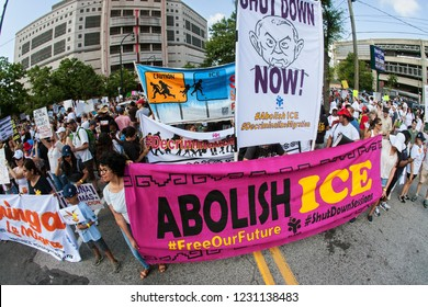 Atlanta, GA / USA - June 30 2018:  People hold anti-ICE and anti-Trump signs and banners as they line up to take part in an immigration law protest and march on June 30, 2018 in Atlanta, GA.