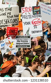 Atlanta, GA / USA - June 30, 2018:  People hold anti-ICE and anti-Trump signs and banners as they gather to take part in an immigration law protest and march on June 30, 2018 in Atlanta, GA.