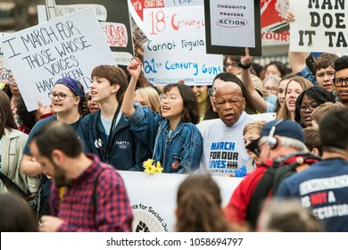 Atlanta, GA / USA - March 24, 2018:  Georgia Congressman John Lewis marches with teenagers at the start of the March For Our Lives anti-gun event on March 24, 2018 in Atlanta, GA.