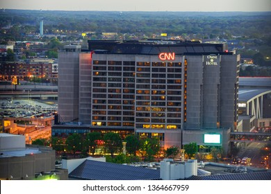 ATLANTA, GA, USA, MARCH 4, 2019 - View of CNN Center world headquarters and Omni Hotel buildings in downtown of city with signs - Image