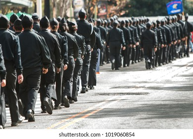 Atlanta, GA, USA - Novem ber 11, 2017:  Dozens of high school military cadets walk to support veterans at the Georgia Veterans Day Parade on November 11, 2017 in Atlanta, GA.