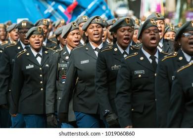 Atlanta, GA, USA - November 11, 2017:  A group of high school junior ROTC cadets sound off while walking in the Georgia Veterans Day Parade, on November 11, 2017 in Atlanta, GA.