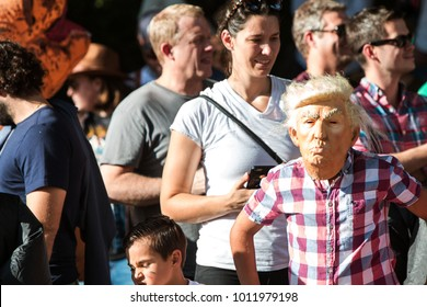 Atlanta, GA, USA - October 21, 2017:  A kid wears a Donald Trump mask at the Little Five Points Halloween Parade on October 21, 2017 in Atlanta, GA.