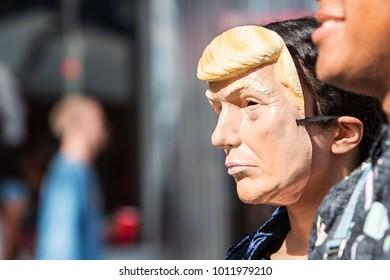Atlanta, GA, USA - October 21, 2017:  A person wears a Donald Trump mask at the Little Five Points Halloween Parade on October 21, 2017 in Atlanta, GA.