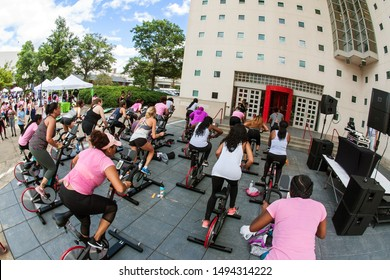 Atlanta, GA / USA - September 15, 2018:  Several women participate in an outdoor spin class at the Pretty Girls Sweat Fest on September 15, 2018 in Atlanta, GA.