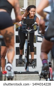 Atlanta, GA / USA - September 15, 2018:  An instructor leads an outdoor spin class as part of the Pretty Girls Sweat Festival, a fitness expo for women, on September 15, 2018 in Atlanta, GA.