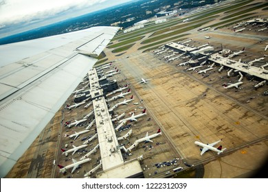 Atlanta, Georgia - 10/20/2018:  aerial view of commercial airliners at the passenger terminal at Hartsfield-Jackson International airport, Atlanta GA..  Passengers departing of just arriving
