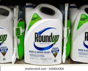 ATLANTA, GEORGIA - JUNE 25, 2019 : Roundup weed killer on shelf at local hardware store.