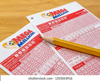 ATLANTA, GEORGIA - MARCH 31, 2019 : Mega Millions lottery ticket play slips. The Mega Millions lotto game is available in 44 states plus the District of Columbia and the U. S. Virgin Islands.