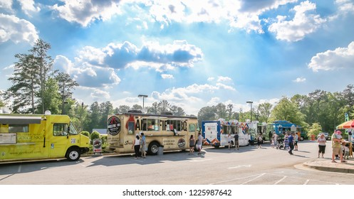 ATLANTA, GEORGIA - May 9, 2015: Preceded by the chuck wagon of the early America through the construction boom's roach coach, the modern food truck has proliferated into a 1.2 Billion dollar industry.