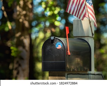 """ATLANTA, GEORGIA - SEPTEMBER 30, 2020 : """"I Voted"""" absentee voter vote by mail sticker on residential U.S. Postal Service residential mailbox."""