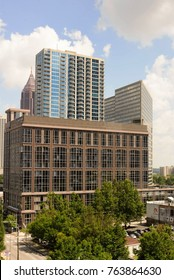 Atlanta, Georgia / United States - August 22, 2017:  downtown Atlanta buildings under a cloudy blue sky