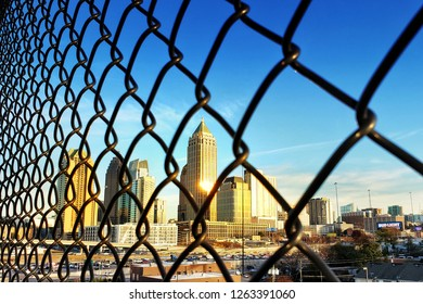 Atlanta, Georgia / The United States - December 16, 2018 : Black fence front of the city view of Midtown under sunset