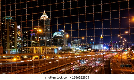 Atlanta, Georgia, / The United States - January 15, 2018 : City night view and the traffic road at Midtown behide the fence, photo shoot at the bridge close to Atlantic station