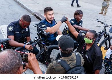 Atlanta, Georgia, US, June 3 2020: Black Lives Matter peaceful protests while state battles COVID-19 pandemic