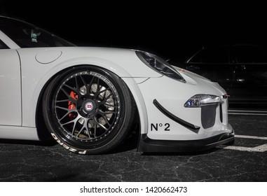 Atlanta Georgia/ USA April 22, 2017: White Porshe 911 race car on Air ride Suspension