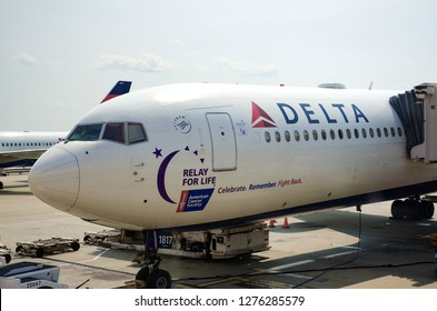 ATLANTA, GEORGIA / USA, August 13, 2018: An airplane with Relay for Life decorations awaits at the airport in Atlanta, Georgia.