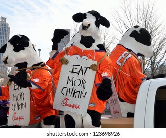 ATLANTA, GEORGIA, USA - DECEMBER 31:  Famous ' Eat Mor Chikin ' cows at parade leading up to the Chick-fil-A bowl game. Event took place at the Georgia Dome with Clemson and LSU on December 31, 2012.