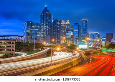 Atlanta, Georgia, USA downtown skyline over the highways at dusk.