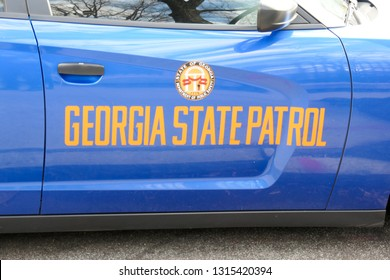 Atlanta, Georgia / USA - January 22, 2019: Georgia State Patrol Blue Car Door on Police Car for State of Georgia Department of Public Safety