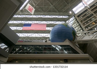 Atlanta, Georgia / USA - January 22, 2019 - Inside View of Atrium of World Headquarters of CNN World News Station and Turner Broadcasting System showing American Flag, CNN  Flag and Globe of the World