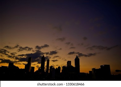 Atlanta, Georgia / USA - January 28, 2012: A dramatic silhouette of a cluster of iconic skyscrapers that define Georgia's city of Atlanta set against the golden and blue hour after sunset.