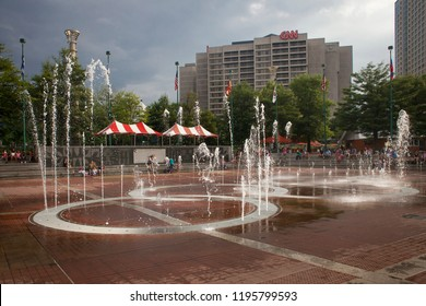 Atlanta, Georgia, USA – July 27, 2015: Sound show at the Centennial Olympic Park fountain with the CNN building at the back