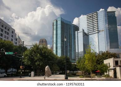 Atlanta, Georgia, USA – July 28, 2015: 10th St in Midtown with the Loews Atlanta Hotel at the back