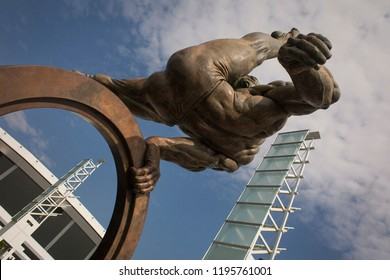 Atlanta, Georgia, USA – July 29, 2015: Low-angle shot of The Gymnast: Flair across America, bronze sculpture made by Richard MacDonald for the 1996 Olympic Games, Centennial Olympic Park