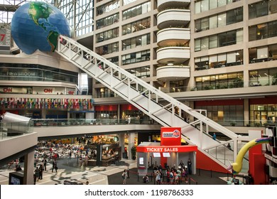 Atlanta, Georgia, USA – July 30, 2015: Horizontal view of the interior of the CNN TV headquarters with the Earth globe at the top of the escalator, Downtown