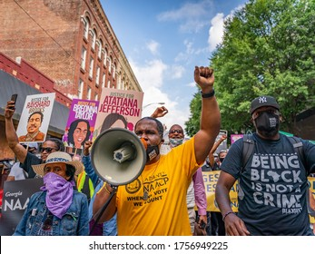 ATLANTA, GEORGIA / USA - June 15, 2020: Scenes from the NAACP-sponsored rally and march to the Georgia State Capitol, which focused on voting rights, police brutality, and criminal legal reform.