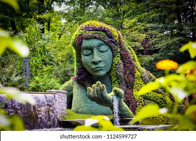 ATLANTA, GEORGIA- USA: June 2018- Earth goddess plant sculpture in the Atlanta Botanical gardens for the, Once Upon a Time theme.