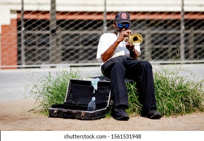 Atlanta, Georgia / USA - Man plays the trumpet on The BeltLine in Atlanta
