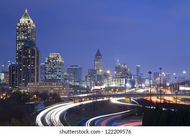 Atlanta. Image of Atlanta skyline and busy highway at night.