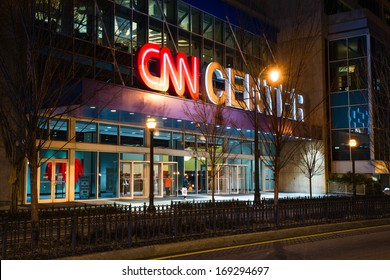 ATLANTA - JAN. 1, 2014: Entrance to the CNN Center in Atlanta at night. The building is the headquarters of CNN, the 24-hour news channel.