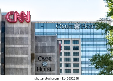 Atlanta, USA - April 20, 2018: CNN Center world headquarters and Omni Hotel buildings in downtown of city with signs