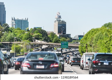 Atlanta, USA - April 20, 2018: I-85 Interstate 85 highway road street during day in capital Georgia city, cars in traffic, exit sign for Marrietta, Chattanooga, overpass bridges