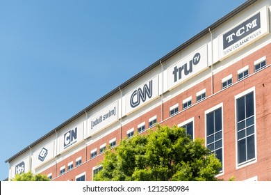 Atlanta, USA - April 20, 2018: CNN Center world headquarters and other cable news networks in downtown of city with signs