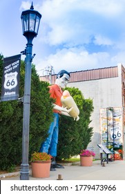 Atlanta USA August 31 2015;  statue Bunyon Muffler man holding gaint hotdog in Atlanta, Illinois, USA, beside sign Get your Kicks on Route 66.