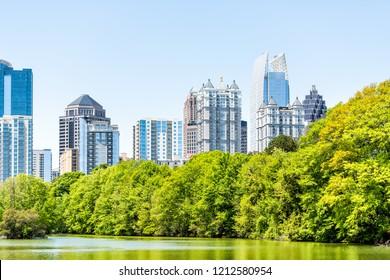 Atlanta, USA Cityscape, skyline view in Piedmont Park in Georgia downtown, green trees, scenic urban city skyscrapers