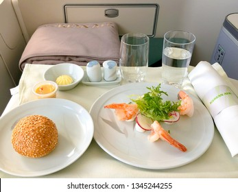 Atlanta USA - March 4, 2019: Korean airlines Boeing 777 business class interior.  photo of Food served on board of the airplane on the table, flight from Atlanta to South Korea.